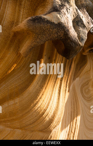 Patterned sandstone rock stained with traces of iron oxides left by percolating ground water. Broken Bay, Australia - Stock Photo