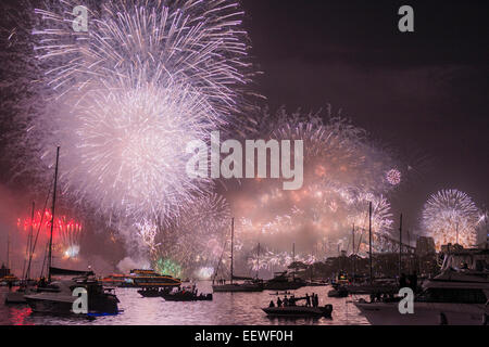 The start of a new year, 2015, with midnight fireworks over the Sydney Opera House, Harbour Bridge and boats in - Stock Photo