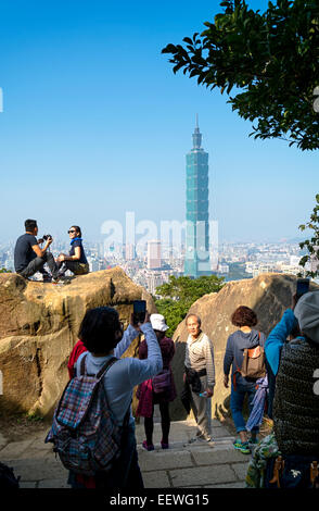 Taipei, Taiwan - Dec 30, 2014: Tourists at the Elephant Mt. in Taipei. Tourists are hiking at the  Nangang District - Stock Photo