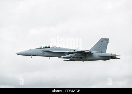 Boeing F/A-18F Super Hornet multi role fighter jet displays at the Royal International Air Tattoo fully loaded with ordnance Stock Photo