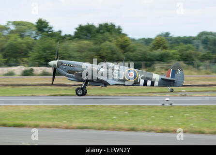 Supemarine Spitfire Fighter Aircraft from the Royal Air Force Battle of Britain Memorial Flight takes off to display - Stock Photo