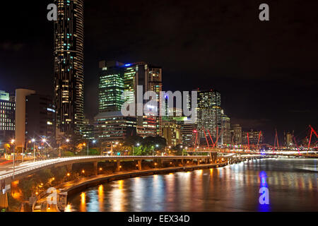 Skyline of Brisbane central business district showing skyscrapers and highrise office blocks by night, Queensland, - Stock Photo