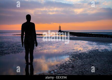 Formby - Lifeboat Road Beach, Liverpool,  Merseyside, UK 22nd January, 2015. UK Weather.  Cast iron men standing - Stock Photo