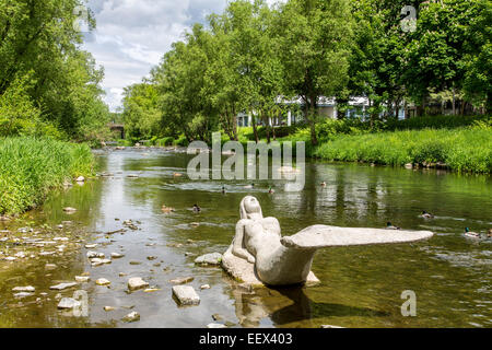 River Ruhr in Arnsberg in Sauerland region, artwork mermaid sculpture in the river - Stock Photo