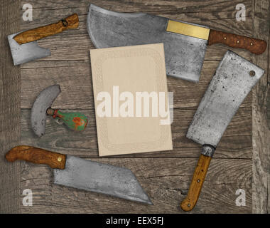 vintage kitchen knives and utensils over wooden  board, blank card for your text - Stock Photo