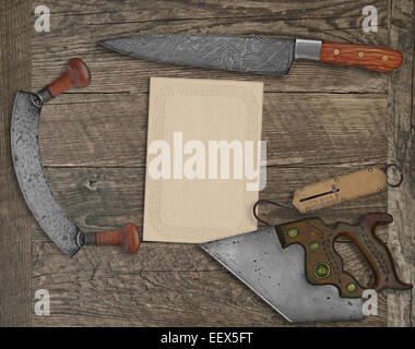 vintage kitchen knives and utensils over wooden board board, blank card for your text - Stock Photo