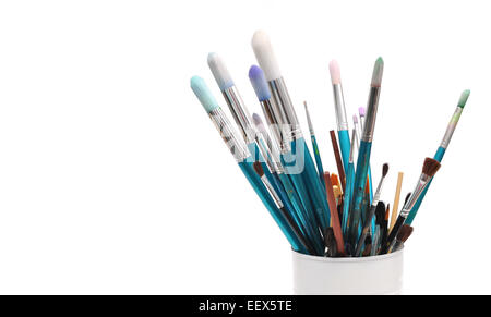 blue paint brushes in cup isolated on white background - Stock Photo