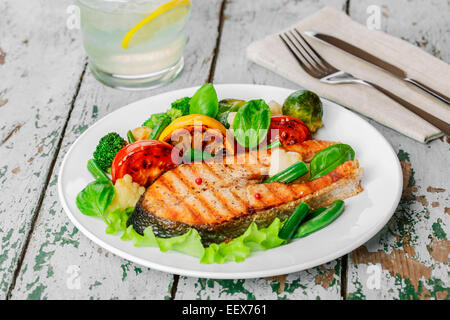 steak grilled salmon with vegetables on a plate - Stock Photo