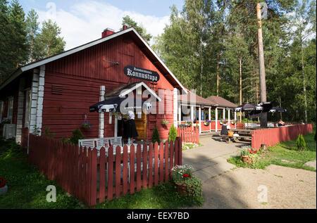 Old log cabin serving as small summertime restaurant for tourists . Konnustupa , Konnuksen kanava , Finland - Stock Photo