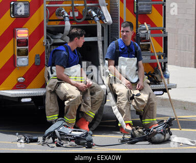 New Haven Firefighters in hazmat suits wait to enter the building after a spill at the New Haven Walgreens (York - Stock Photo