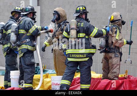 New Haven Firefighters in hazmat suits clean off after a spill at the New Haven Walgreens (York Street) that sent - Stock Photo