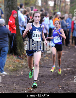 Hannah DeBalsi of Staples on her way to the State Open Cross Country Championship win at Wickham Park in Manchester. - Stock Photo