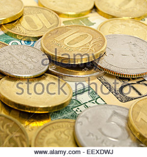 Still-life with coins and banknotes of different countries. - Stock Photo