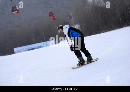 Yabuli, Dec. 5. 18th Jan, 2015. A tourist skis at a ski resort in Yabuli town, northeast China's Heilongjiang Province, - Stock Photo