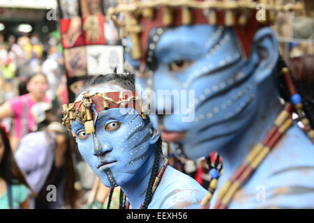 Performers wearing vibrant costumes during the Ati Atihan festival. - Stock Photo