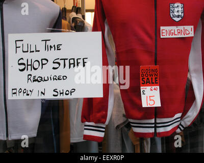 Employment Opportunities occupation Job  opportunity Full time shop assistant required  signage on window during - Stock Photo