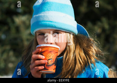 Young girl outdoors in winter - Stock Photo
