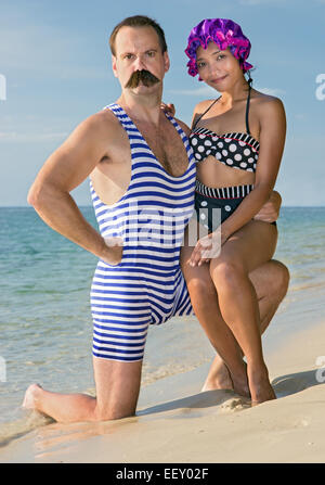 woman with a man in a retro swimsuit on the beach - Stock Photo