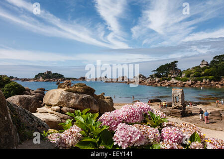 Beach at Ploumanac'h (Plage de St Guirec) and the shrine to Saint Guirec with view to the Ile de Costaèrés, Brittany - Stock Photo