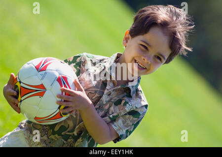 Young boy playing with soccer ball - Stock Photo