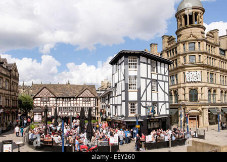 16th century timbered The Old Wellington Inn 1552 timbered building with crowds of people in beer garden. Manchester - Stock Photo