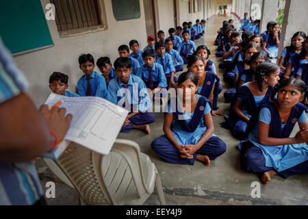 Teacher giving a brief at a free school supported by an international Buddhism organization in Dungeshwari village - Stock Photo