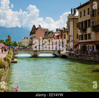 Tourists in Annecy, France in summer - Stock Photo