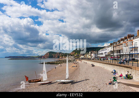 Sidmouth, East Devon, England, UK - seafront, beach and small yachts in summer - Stock Photo