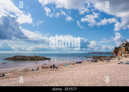 Sidmouth, East Devon, England, UK - people on the beach in summer - Stock Photo