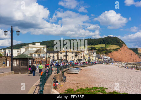 Sidmouth, East Devon, England, UK - people walking along the promenade in high summer - Stock Photo