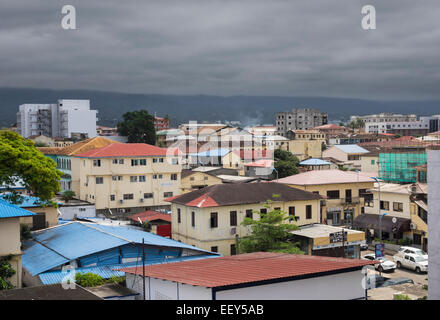 View over the rooftops of city of Malabo, Equatorial Guinea, west Africa with stormy weather - Stock Photo