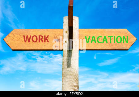 Wooden signpost with two opposite arrows over clear blue sky, Work and Vacation signs, Work Life Balance conceptual - Stock Photo