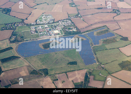Large solar panel array in fields around Highpoint Prison near Newmarket, England - Stock Photo