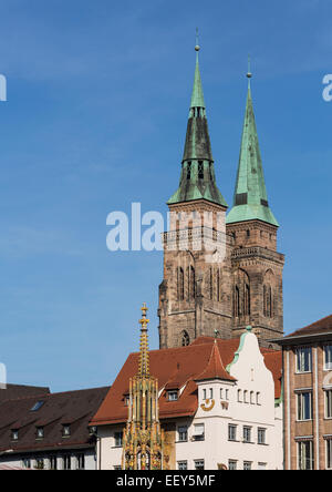 The Schoner Brunnen fountain with St Sebald Church behind in Nuremberg, Germany - Stock Photo
