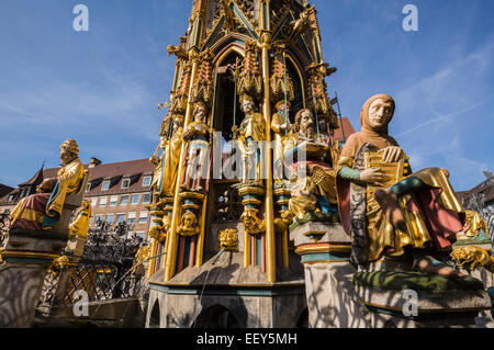 Detail of the Schoner Brunnen fountain and statue in market square of Nuremberg, Germany - Stock Photo