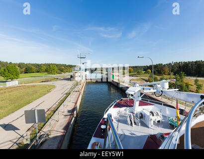 Cruise boat leaves Hilpoltstein lock on the Danube canal near the European Continental Divide, Germany - Stock Photo