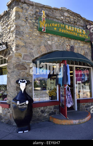 A bear statue stands in front of a souvenir store on the main street in the town of Jasper - Stock Photo