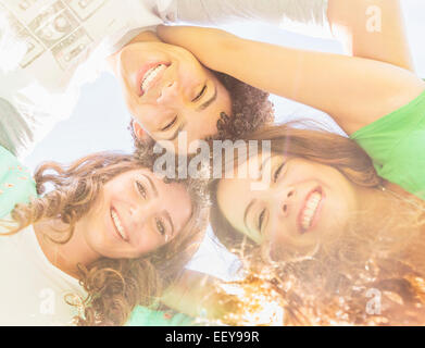 Portrait of friends (14-15) looking down - Stock Photo
