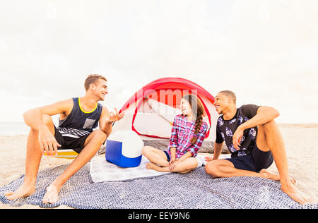 Young people relaxing on beach - Stock Photo