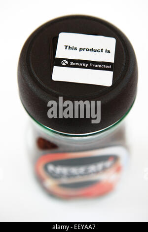 Security protection label on jar of coffee - Stock Photo