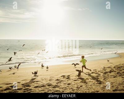 USA, California, Laguna Beach, Boy (6-7) running on beach - Stock Photo