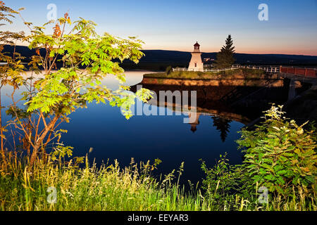 Canada, New Brunswick, Anderson Hollow Lighthouse by pond at dusk - Stock Photo