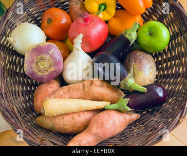 Mixed fruit and vegetables in a basket - Stock Photo