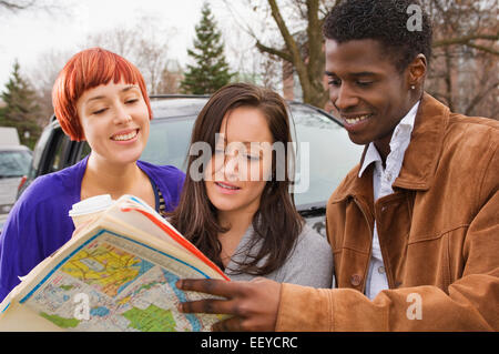 Friends looking at map - Stock Photo