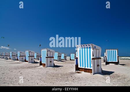 Beach chairs on the beach of Warnemünde. - Stock Photo