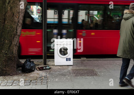 Washing machine dumped by side of road, London, UK - Stock Photo