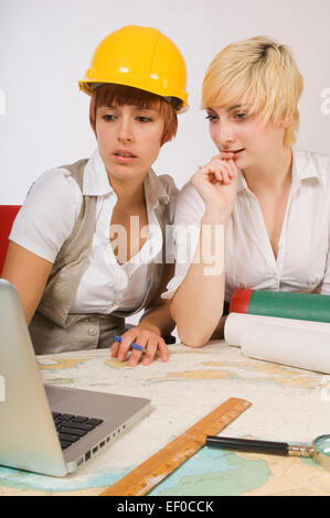 Two women looking at laptop - Stock Photo
