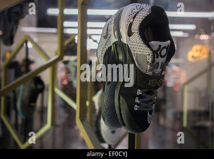 Sneakers on display at the Nike 'House of Hoops' pop-up store next to Madison Square Garden in New York on Thursday, - Stock Photo