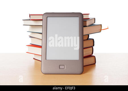 ebook reader vs pile of books - Stock Photo