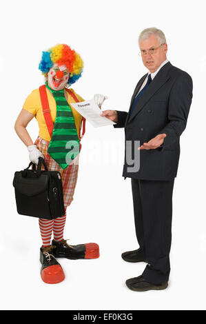Businessman looking at clown's resume - Stock Photo